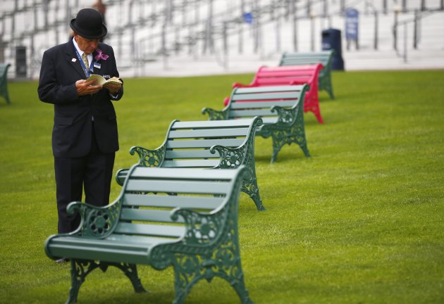 A steward studies the race card on the second day of the Royal Ascot horse racing festival at Ascot
