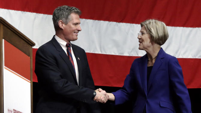FILE - In this Oct. 10, 2012, file photo U.S. Senate candidates for Massachussetts, Republican Sen. Scott Brown and Democratic challenger Elizabeth Warren, shake hands prior to their debate in Springfield, Mass. Brown is talking bipartisanship in his race against Warren. He won a special election in January 2010 to fill the seat of the late Sen. Edward Kennedy, but this election he'll likely face 700,000-800,000 more voters, many Democrats or independents who favor Democrats.(AP Photo/Elise Amendola, File)