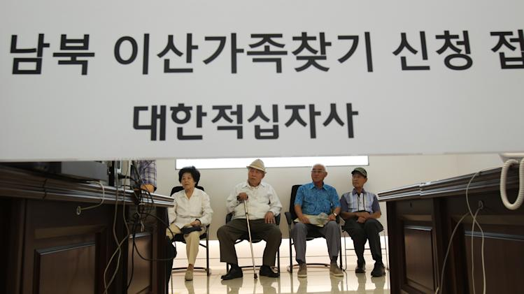 "FILE - In this Aug. 24, 2013 file photo, South Korean applicants for the reunions wait for the announcements of the names of South Korean candidates who could meet their North Korean relatives in upcoming family reunions at the headquarters of Korea Red Cross in Seoul, South Korea. North Korea has indefinitely postponed reunions of families separated by the Korean War that had been set to start Wednesday, Sept. 25, 2013. The North's statement Saturday, Sept. 21, 2013 didn't provide specifics on its decision but accused unidentified conservatives in Seoul of seeking confrontation with Pyongyang. North Korea routinely makes such claims. The Korean writing reads "" Applications reception of separated families."" (AP Photo/Ahn Young-joon, File)"