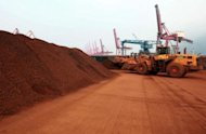 This file photo shows soil containing rare earth minerals to be loaded at a port in Lianyungang, east China's Jiangsu province, in 2010. China's restrictions on exports of rare earths are aimed at maximising profit, strengthening its homegrown high-tech companies and forcing other nations to help sustain global supply, experts say