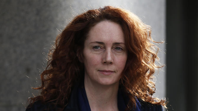 Rebekah Brooks, former News International chief executive leaves the Central Criminal Court in London where she appeared to face charges related to phone hacking, Wednesday, Feb. 19, 2014. Jurors at Britain's phone-hacking trial were told Wednesday that former Prime Minister Tony Blair allegedly offered to work as an unofficial adviser to Rupert Murdoch as revelations of illegal phone hacking engulfed the mogul's media empire. (AP Photo/Sang Tan)