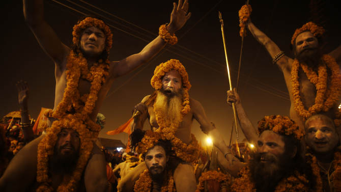 """""""Naga"""" sadhus or Hindu naked holy men from the Niranjani """"Akhada"""" or sect, take out a procession to take a ritual dip at """"Sangam,"""" the confluence of Hindu holy rivers Ganges, Yamuna and the mythical Saraswati, during the Maha Kumbh festival at Allahabad, India, Sunday, Feb. 10, 2013. Millions of devout Hindus and thousands of Hindu holy men are expected to take a dip at Sangam on Sunday, the most auspicious day according to the alignment of stars, for the entire duration of Maha Kumbh festival, which lasts for 55 days. (AP Photo/ Saurabh Das)"""