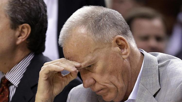 Philadelphia 76ers head coach Doug Collins studies a stat sheet as his team plays the Indiana Pacers in the first half of an NBA basketball game in Indianapolis, Wednesday, April 17, 2013. (AP Photo/Michael Conroy)