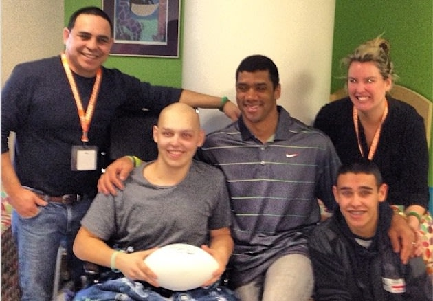 Seahawks quarterback Russell Wilson visits cancer patient David Padilla — Twitter