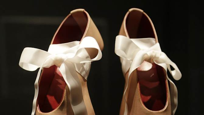 """This Feb. 11, 2013 photo shows a pair of shoes designed by Noritake Tatehana for Lady Gaga displayed at the """"Shoe Obsession"""" exhibit at The Museum at the Fashion Institute of Technology Museum in New York. The exhibition, showing off 153 specimens, runs through April 13. (AP Photo/Kathy Willens)"""