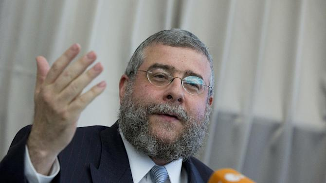 Rabbi Pinchas Goldschmidt, president of the Conference of European Rabbis, gestures during a news conference in Berlin, Germany, Thursday, July 12, 2012. The Conference of European Rabbis has called an emergency meeting in Berlin this week to discuss a German court ruling that circumcising young boys for religious reasons amounts to bodily harm even if parents agree to it. (AP Photo/Gero Breloer)