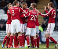 Aberdeen players celebrate after Jonny Hayes scores the opening goal at St Mirren Park