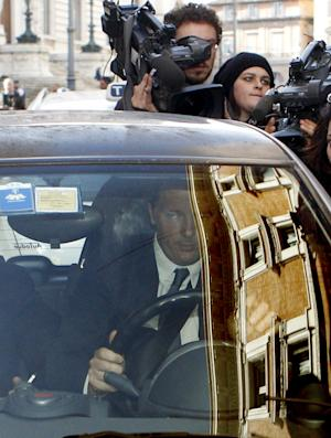 Florence Mayor and Italian center-left Democratic Party leader Matteo Renzi drives away as he is chased by reporters following a meeting with Premier Enrico Letta at Chigi Palace government office, in Rome, Wednesday, Feb. 12, 2014. Letta battled Wednesday to stay in office amid a power play by supporters of the dynamic head of his party, Renzi, to replace him as premier in the latest chapter to convulse Italy's fragile political stability. Renzi arrived at Letta's office at Palazzo Chigi for a make-or-break meeting ahead of a Democratic Party summit on Thursday that is expected to determine the government's next steps. (AP Photo/Riccardo De Luca)