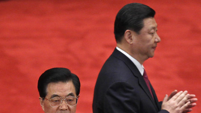 FILE - In this May 4, 2012 file photo, Chinese President Hu Jintao, front, and Vice President Xi Jinping, back, arrive at a conference to celebrate the 90th anniversary of the founding of Chinese Communist Youth League at the Great Hall of the People in Beijing, China. As Hu steps down as head of China's Communist Party after 10 years in power, he's hearing something unusual for a Chinese leader: sharp criticism. (AP Photo/Alexander F. Yuan, File)