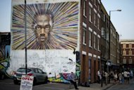 "A mural in east London by street artist James Cochran shows the face of the world's fastest man Usain Bolt. His image of Bolt, with brightly coloured rays pulsing from his face in all directions, is his ""homage to the buzz around the Olympics"""