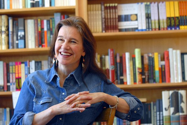 "FILE - In this Friday, May 16, 2008, file photo, author Louise Erdrich reflects on growing up in North Dakota and her new book ""The Plague of Doves"" at her store BirchBark Books in Minneapolis. Louise Erdrich is more than this year's winner of the National Book Award for fiction. She's a bookstore owner and has some ideas for what customers might pick up as holiday gifts. (AP Photo/Dawn Villella, File)"