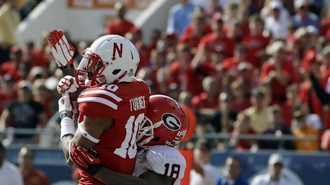 Nebraska wide receiver Jamal Turner (10) catches a 14-yard touchdown pass in the end zone in front of Georgia safety Bacarri Rambo (18) during the first half of the Capital One Bowl NCAA football game, Tuesday, Jan. 1, 2013, in Orlando, Fla. (AP Photo/John Raoux)