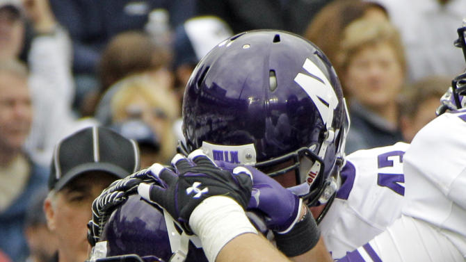 Northwestern running back Venric Mark (5) celebrates with teammates after rushing for a touchdown during the second quarter an NCAA college football game against Penn State in State College, Pa., Saturday, Oct. 6, 2012. (AP Photo/Gene J. Puskar)