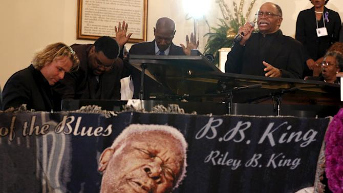 Swiss pianist Silvan Zingg joins in to play at B.B. King's funeral in Indianola, Mississippi