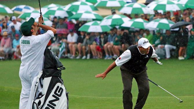 Angel Cabrera, right, reacts with his son Angel Cabrera Jr., who caddies for him, after he almost chipped in for birdie on the first hole of a playoff during the Masters golf tournament, Sunday, April 14, 2013, in Augusta. Cabrera was defeated by Adam Scott in the playoff. (AP Photo/Atlanta Journal-Constitution, Curtis Compton) MARIETTA DAILY OUT; GWINNETT DAILY POST OUT; LOCAL TV OUT; WXIA-TV OUT; WGCL-TV OUT