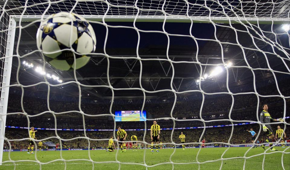 The ball hits the back of the net after Bayern's Arjen Robben of the Netherlands, unseen, scores during the Champions League Final soccer match between Borussia Dortmund and Bayern Munich at Wembley Stadium in London. Saturday, May, 25, 2013. (AP Photo/Matt Dunham)
