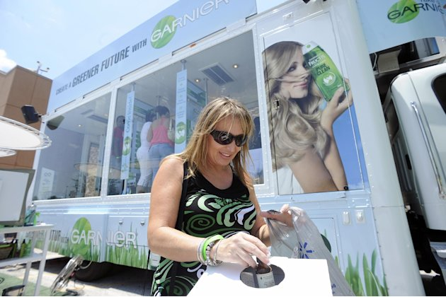 "COMMERCIAL IMAGE - Lynn Rodriguez recycles used beauty products with Terracycle at ""The Garnier Greener Tour"" bus on Saturday, June 30, 2012 in Brandon, Fla. (Photo by Brian Blanco/Invision for Garnie"