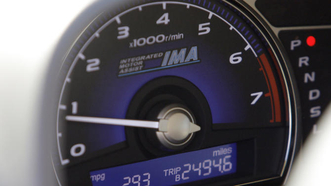 The mileage meter on Heather Peters' 2006 Honda Civic reads 29.3 mpg Tuesday, Jan. 3, 2012, outside small claims court in Torrance, Calif. Peters, who says the car never achieved the 50 mpg Honda claimed in its advertising, has opted out of a class action settlement agreed to by Honda because it does not provide enough remuneration. (AP Photo/Reed Saxon)