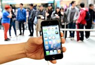 Apple's iPhone 5 is shown outside the US company's flagship store in Sydney, September 21, 2012. Technology giants including Apple and Microsoft on Friday defended their pricing policy in Australia at an official inquiry launched over concerns that they were overcharging customers