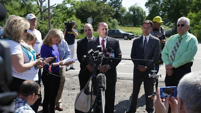Robert Foley, center, special agent in charge of the FBI's Detroit division, addresses the media in Oakland Township, Mich., Wednesday, June 19, 2013 where he announced the FBI was ending the search operations for the remains of Teamsters union president Jimmy Hoffa who disappeared from a Detroit-area restaurant in 1975. (AP Photo/Carlos Osorio)