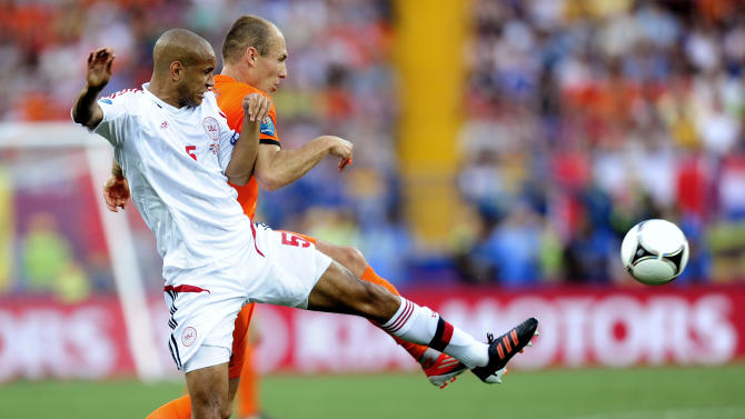 Denmark's Simon Busk Poulsen, left, and Arjen Robben go for the ball during the Euro 2012 soccer championship Group B match between the Netherlands and Denmark in Kharkiv , Ukraine, Saturday, June 9, 2012. (AP Photo/Manu Fernandez)