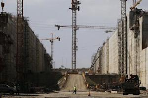 A worker walks at the Panama Canal expansion project site during an organized tour by the Panama Canal authorities in Panama City