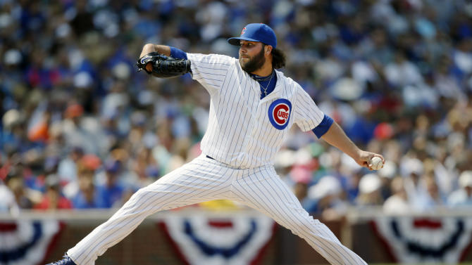 Chicago Cubs relief pitcher James Russell (40) throws against the Miami Marlins during the eighth inning of a baseball game on Friday, July 3, 2015, in Chicago. (AP Photo/Andrew A. Nelles)