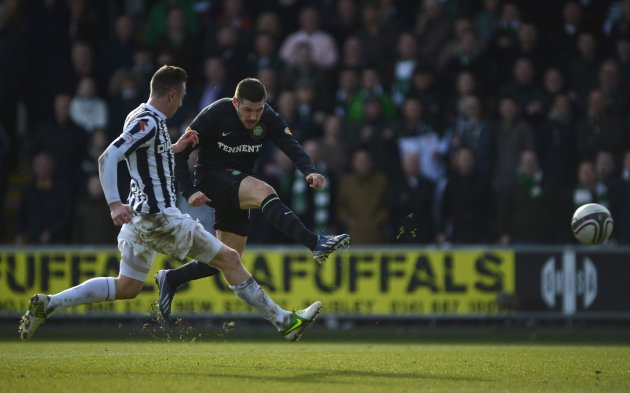 St Mirren's Paul Dummett challenges Celtic's Gary Hooper during their Scottish FA Cup 6th round soccer match at St Mirren Park Stadium in Paisley, Scotland