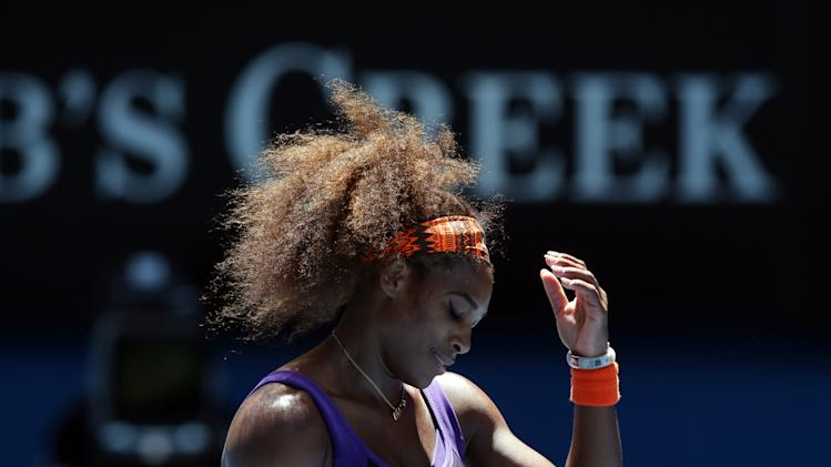 Serena Williams of the US reacts during her quarterfinal match against compatriot Sloane Stephens at the Australian Open tennis championship in Melbourne, Australia, Wednesday, Jan. 23, 2013. (AP Photo/Aaron Favila)
