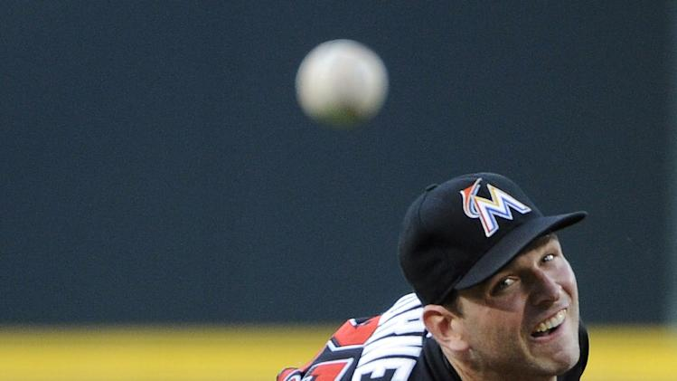 Miami Marlins starting pitcher Jacob Turner delivers to the Atlanta Braves during the first inning of a baseball game Tuesday, July 22, 2014, in Atlanta. (AP Photo/David Tulis)