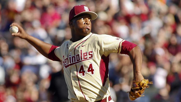FILE - In this March 2, 2014, file photo, Florida State relief pitcher Jameis Winston throws in the ninth inning of an NCAA college baseball game against Miami in Tallahassee, Fla. The Florida State baseball team has indefinitely suspended Heisman Trophy winner Jameis Winston, who is a relief pitcher for the Seminoles. Baseball coach Mike Martin said in a statement Wednesday, April 30, 2014, that Winston was issued a citation the night before, but he did not give specifics. The Leon County Sheriff's Office has declined comment. (AP Photo/Phil Sears, File)