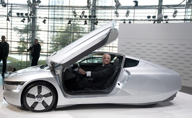 Volkswagen AG CEO, Martin Winterkorn sits in a Volkswagen VW XL1 test model prior to a press conference in Wolsburg, Germany, Thursday March 10, 2011. Volkswagen is sticking with its planned merger wi