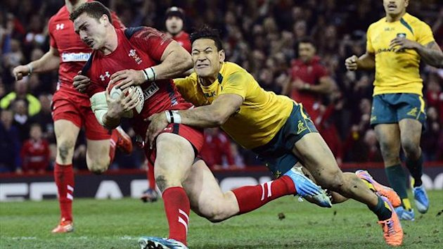 Australia's Israel Folau (R) fails to stop Wales's George North (L) from scoring a try during their international rugby union match at the Millenium Stadium in Cardiff (Reuters)