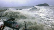 In this photo released by Yeosu City and distributed via Yonhap News Agency, high waves caused by Typhoon Sanba crash on beach in Yeosu, south of Seoul, South Korea, Monday, Sept. 17, 2012. (AP Photo/Yeosu City via Yonhap) KOREA OUT