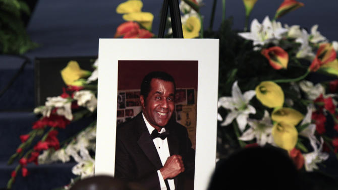 A portrait of the late boxing trainer Emanuel Steward is seen during his funeral service at the Greater Grace Temple in Detroit, Tuesday, Nov. 13, 2012. (AP Photo/Carlos Osorio)
