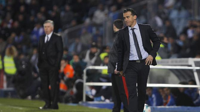Getafe's coach Luis Garcia, right, watches the action during a Spanish La Liga soccer match between Real Madrid and Getafe at the Coliseum Alfonso Perez stadium in Madrid, Spain, Sunday, Feb. 16, 2014