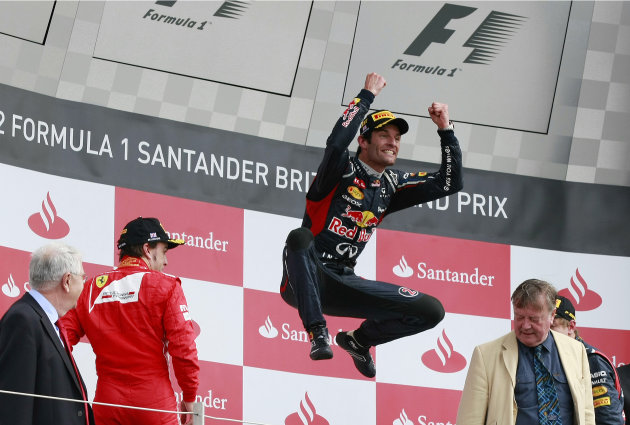 Australia's Mark Webber celebrates after winning the Formula One British Grand Prix at the Silverstone circuit, Silverstone, England, Sunday, July 8, 2012. (AP Photo/Tim Hales)