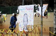 A banner with well-wishing messages left for former South African president Nelson Mandela, on July 19, 2013, outside the Pretoria hospital where he is in a critical condition. South Africa's presidency declined to comment on a report the anti-apartheid hero had undergone an operation