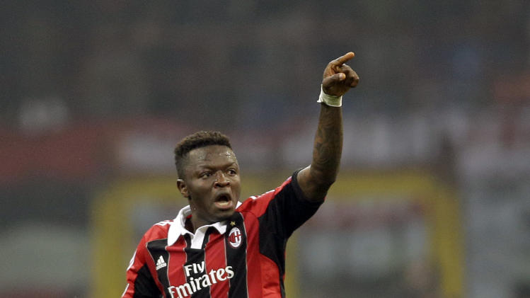 AC Milan midfielder Sulley Muntari, of Ghana, celebrates after scoring his side's second goal during the Champions League round of 16, first leg soccer match between AC Milan and Barcelona, at the San Siro stadium in Milan, Wednesday, Feb. 20, 2013. (AP Photo/Luca Bruno)
