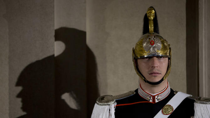 The shadow of a courassier presidential guard is cast on the wall at Rome's Quirinale presidential palace Saturday Dec. 22, 2012. Italy's president has dissolved parliament following Premier Mario Monti's resignation, formally setting the stage for general elections in February in which Monti's participation remains unclear. President Giorgio Napolitano signed the decree Saturday after consulting with political leaders. Monti, appointed 13 months ago to steer Italy from a Greek-style debt crisis, stepped down Friday after ex-Premier Silvio Berlusconi's party withdrew its support for his technical government. (AP Photo/Andrew Medichini)