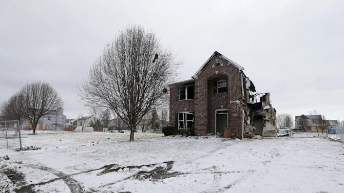 A home in the Richmond Hills neighborhood that was damaged by an explosion on Nov. 10, 2012, is seen Friday, Dec. 21, 2012, in Indianapolis. The massive explosion sparked a huge fire and killed two people in Indianapolis. Prosecutors have charged a homeowner, her boyfriend and his brother with murder after causing the massive house explosion. (AP Photo/Darron Cummings)