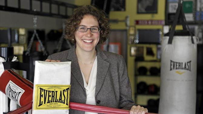 In this photo taken March 19, 2013, Dr. S. Elizabeth Zauber M.D. an Assistant Professor of Neurology at Indiana University School of Medicine, and a movement disorders specialist, poses ringside at Rock Steady Boxing in Indianapolis, where she serves on the board. (AP Photo/Michael Conroy)