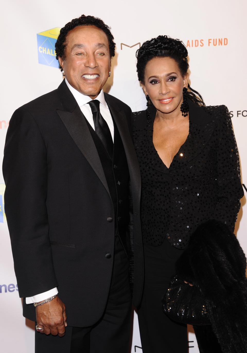 Singer Smokey Robinson and Claudette Robinson attend the Elton John AIDS Foundation 10th Annual Enduring Vision Benefit, on Wednesday, Oct. 26, 2011, in New York. (AP Photo/Peter Kramer)