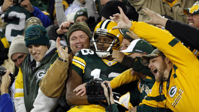 Green Bay Packers' Randall Cobb (18) leaps into the crowd after an 80-yard punt return for a touchdown during the first half of an NFL football game against the Minnesota Vikings Monday, Nov. 14, 2011, in Green Bay, Wis. (AP Photo/Mike Roemer)