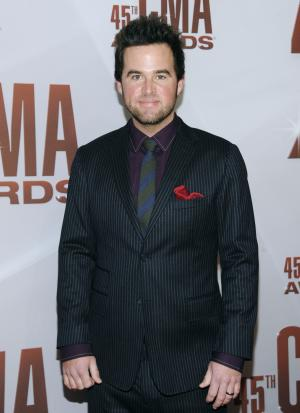 """FILE - In this Nov. 9, 2011 file photo, David Nail arrives at the 45th Annual CMA Awards in Nashville. Going into the recording studio for his third album, country singer-songwriter David Nail was ready to move beyond his reputation for emotionally heavy, slow ballads that painted him professionally into a box. So when he heard the song that would eventually become the first single from """"I'm A Fire,"""" he realized it was a turnaround for both his career and his attitude.(AP Photo/Evan Agostini)"""