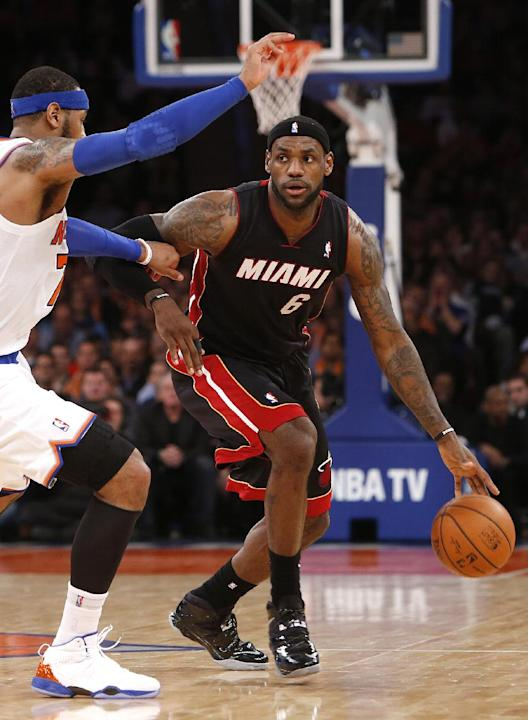 Miami Heat's LeBron James (6) advances the ball against New York Knicks' Carmelo Anthony during the second half of an NBA basketball game Saturday, Feb. 1, 2014, in New York.  Miami won 106-91