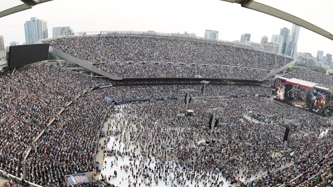 Spectators fill the Soldier Field stadium as rock band The Grateful Dead performs during the first of their last three concerts, in Chicago, Illinois