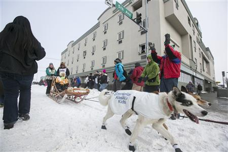 Lindner's team trots through downtown during the ceremonial start to the Iditarod dog sled race in Anchorage, Alaska