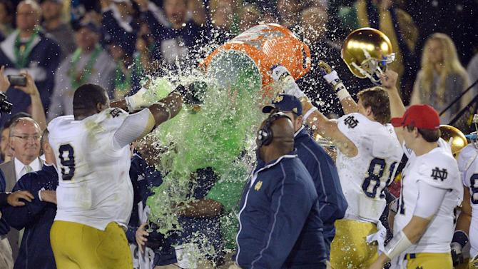 Notre Dame coach Brian Kelly receives a dousing as other team members celebrate after Notre Dame defeated Southern California 22-13 in an NCAA college football game, Saturday, Nov. 24, 2012, in Los Angeles. (AP Photo/Mark J. Terrill)