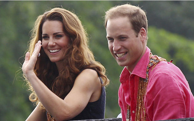 Britain's Prince William and his wife Kate, the Duke and Duchess of Cambridge, smile as they watch a shark ceremony as they arrive at Marapa Island, Solomon Islands, Monday, Sept. 17, 2012. (AP Ph